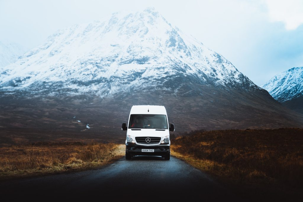 mercedes camper van in front of mountains