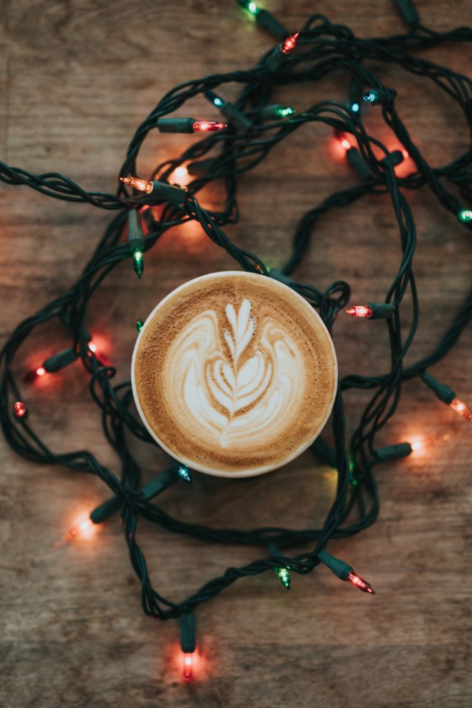 coffee surrounding by christmas lights
