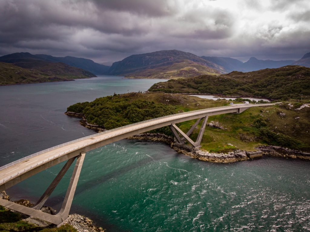A bridge going over a body of water connecting a road