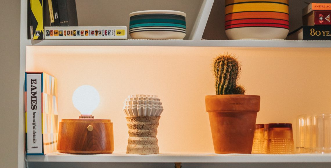 Shelf filled with items and a light