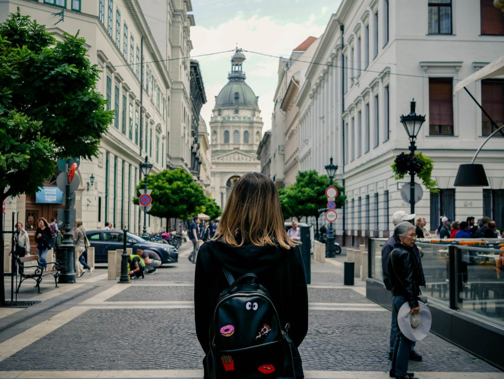 woman carrying backpack in a street