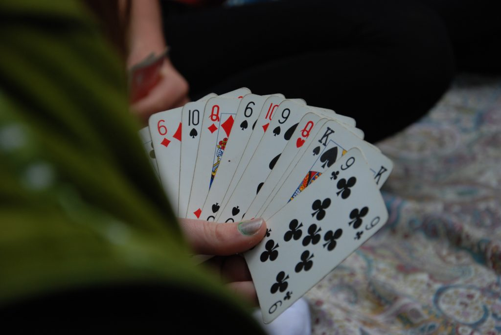 Woman holding multiple playing cards
