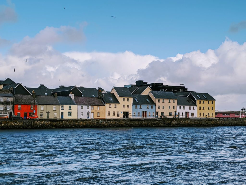 Row of colourful houses in front of the sea