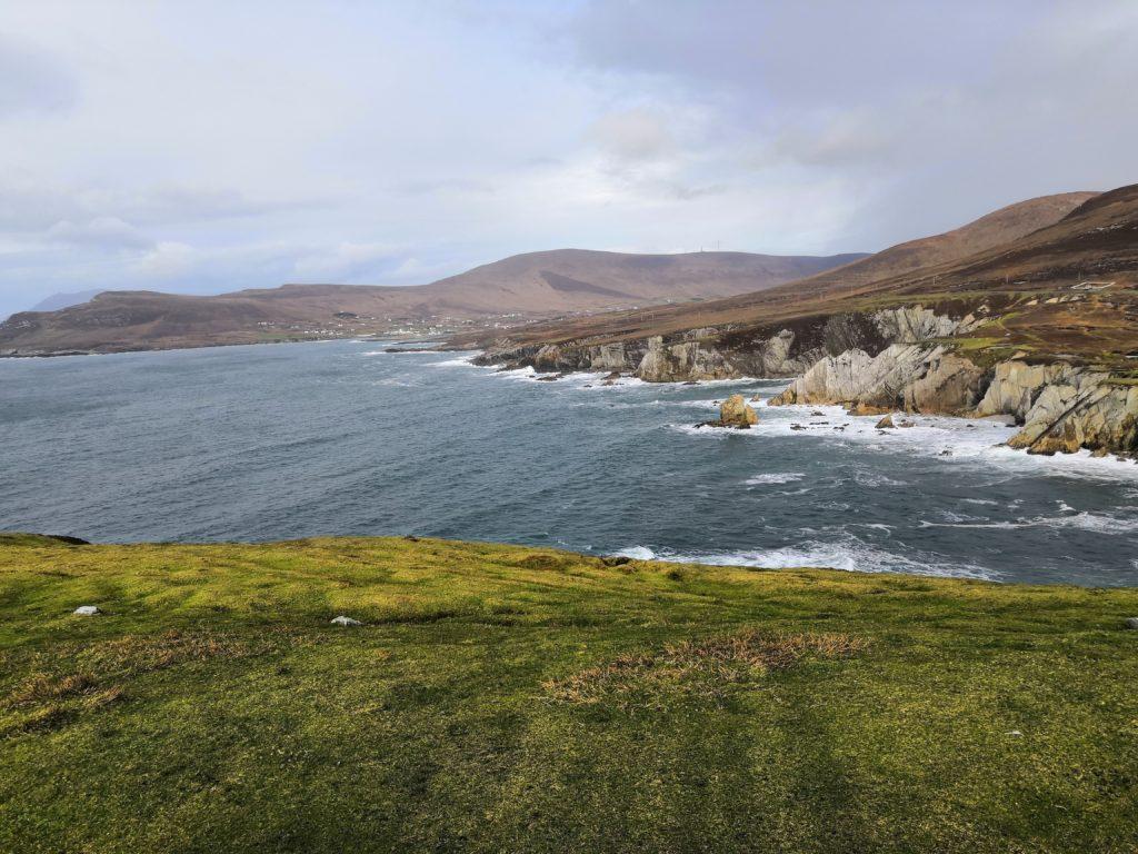Rocky coastline with still waters below the cliffs