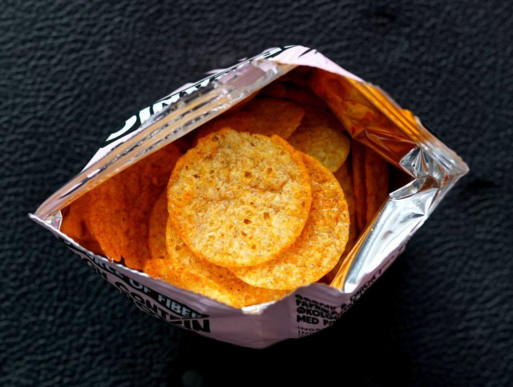 An open packet of crisps