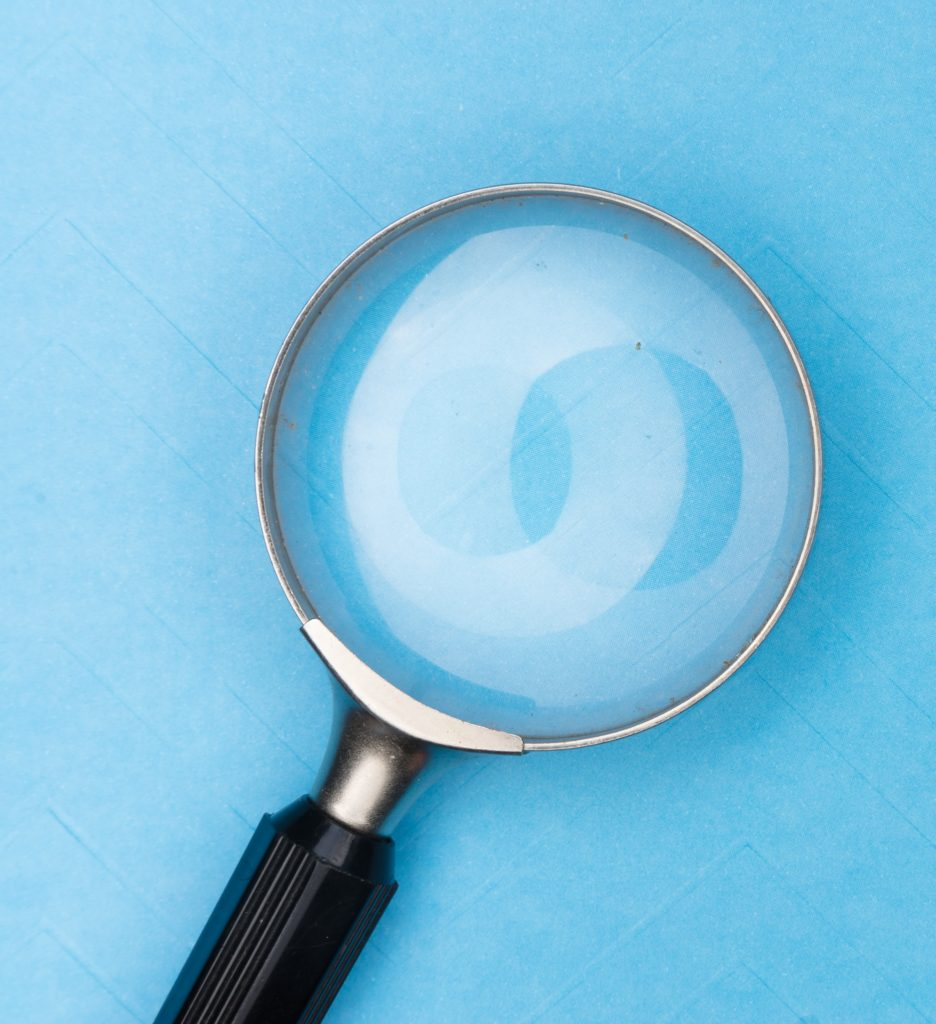 Magnifying glass on a blue table